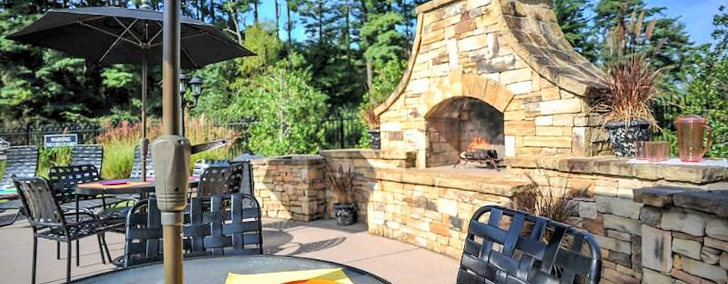 Relax by the poolside fireplace available at some locations during your extended stay in Knoxville.