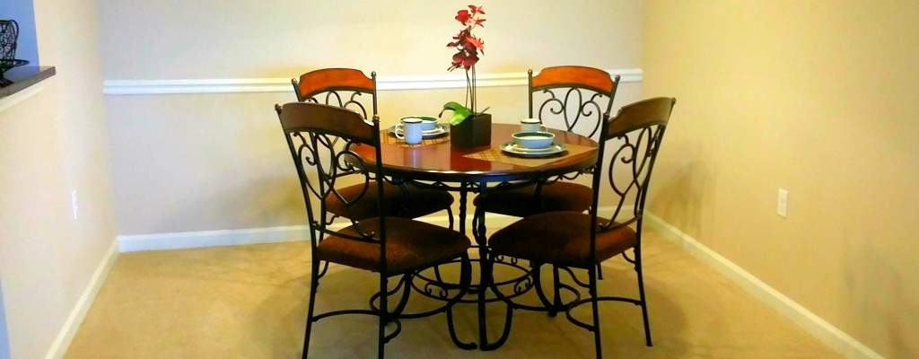 Fully equipped dining room set up for convenience in our corporate apartments in Knoxville .